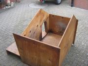 Fahrbare Holzhundehütte zu