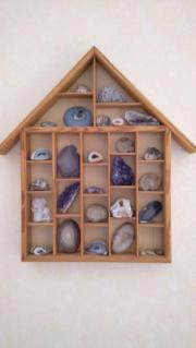Holzhaus als Wanddekoration